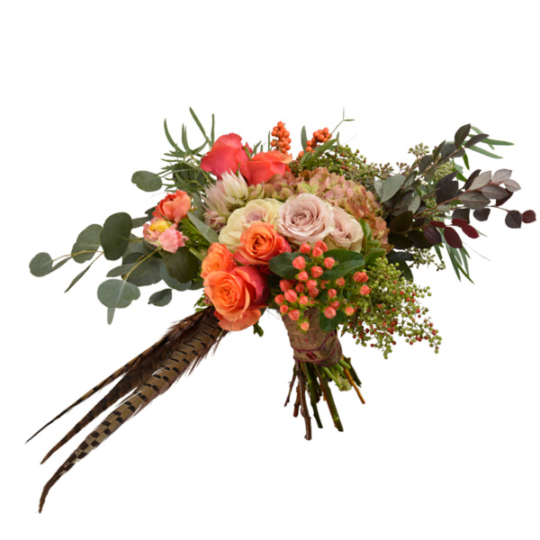 Fall bouquet with antique hydrangeas, bridal protea, seeded eucalyptus, pepper and ilex berries, champagne roses, ranunculus and pheasant feathers. Ted and Debbie's Flower and Garden, Tulsa.