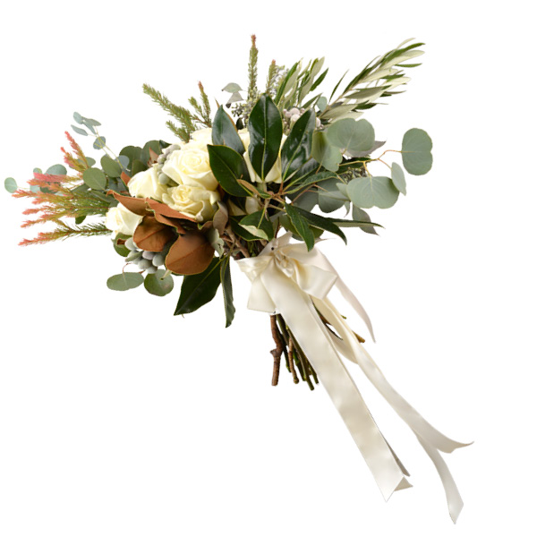 Winter white bouquet with magnolias, white garden roses, Brazilian bell, seeded eucalyptus and protea greens Ted and Debbie's Flower and Garden, Tulsa.