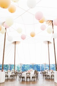 Ambience was important to the couple, who chose to hold the reception in a tent with a ceiling decorated in oversized pastel balloons. A pink ombre style tied the wedding together in every aspect – from the floral arrangements to the bridesmaids' gowns.